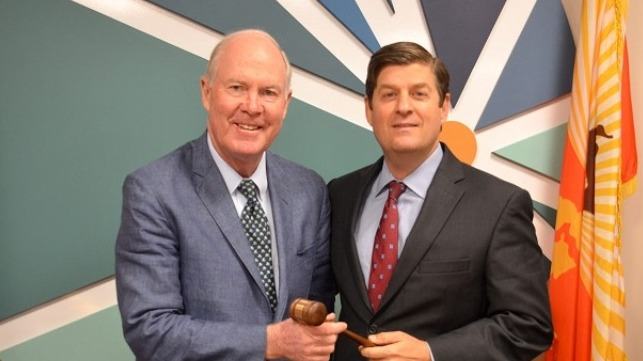 JAXPORT incoming Chairman John Baker (L) accepts the gavel from Immediate Past Board Chairman John Falconetti.