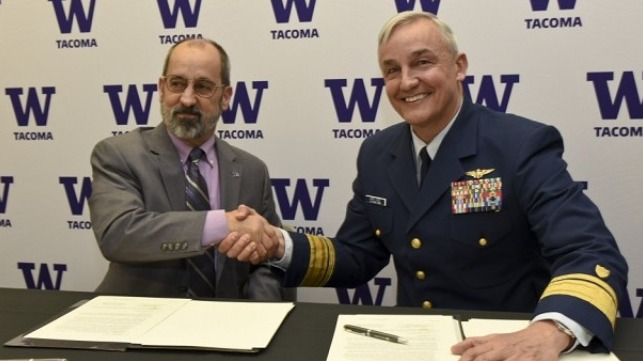 Rear Adm. Jack Vogt, commander, 13th Coast Guard District, shakes hands with Mark A. Pagano, chancellor, University of Washington Tacoma