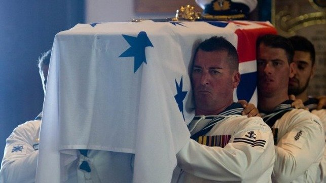 Pallbearers from HMAS Melbourne (III) carry the late Captain John Stevenson, AM, RAN (Retd) into the Naval Chapel at HMAS Kuttabul for his funeral.