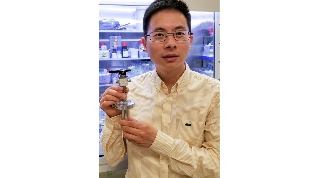 Wei Chen holds the prototype battery
