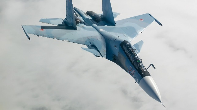 Russian fighter jet buzzes U.S. spy plane in Black Sea, Navy says