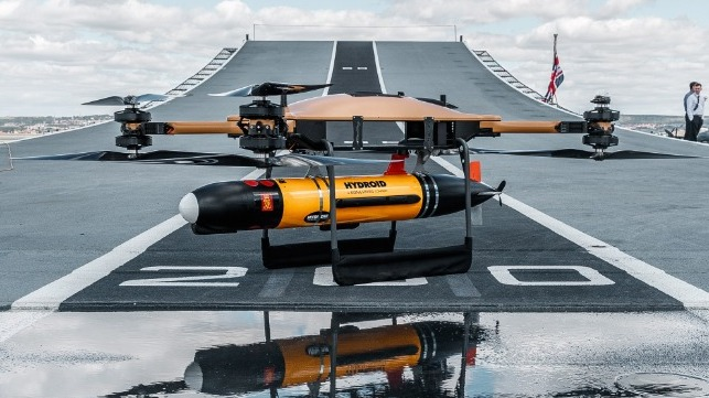 A UAV carrying an AUV on the deck of the carrier HMS Prince of Wales (Royal Navy)