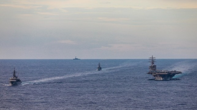 USS Ronald Reagan under way with two Japan Maritime Self Defense Force training ships, South China Sea, July 7 (USN)