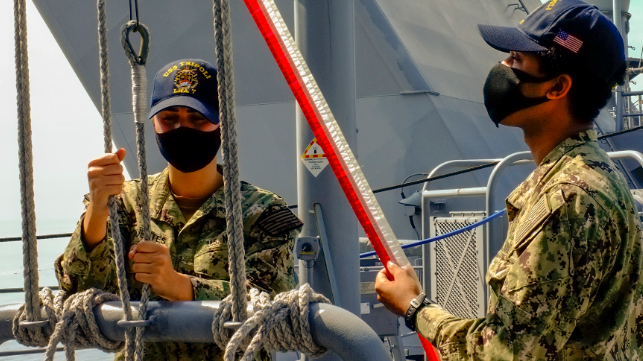 Sailors raise the commissioning pennant aboard USS Tripoli, July 15 (USN)