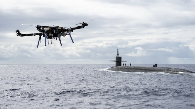 US Navy tests drone delivery to submarine at sea