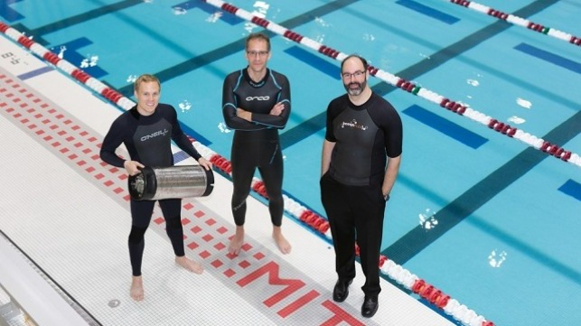 From left, graduate student Anton Cottrill, Dr. Jacopo Buongiorno and Dr. Michael Strano try out their neoprene wetsuits at a pool at MIT?s athletic center. Cottrill is holding the pressure tank used to treat the wetsuits with heavy inert gasses. (Courtesy photo/Susan Young)
