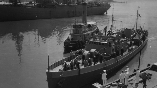 the crew of icarus disembarks surviving u-352 crew members at the  charleston navy yard in charleston, s c  (coast guard collection)