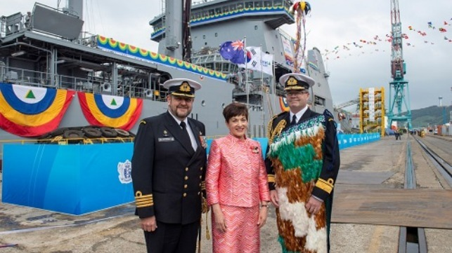 Captain Simon Rooke, Commanding Officer (Designate) of Aotearoa, Dame Patsy Reddy Governor General of New Zealand and the Chief of Navy, Rear Admiral David Proctor, in front of Aotearoa.