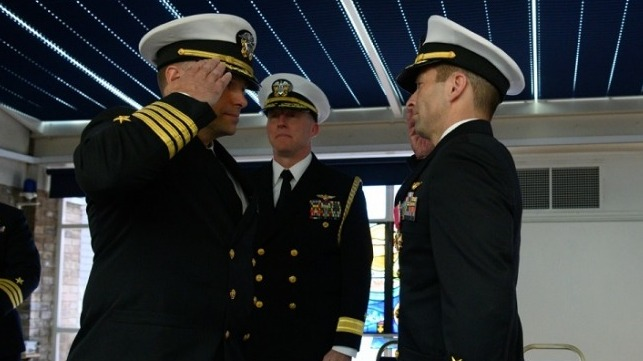 Capt. Kevin M. Quarderer, right, is relieved by Capt. James P. Borghardt during a change of command ceremony for the Office of Naval Research Global. Rear Adm. David G. Manero, center, U.S. senior defense official/defense attaché, United Kingdom, presides.