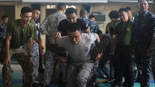 U.S., Thai and Indonesian Coast Guardsmen and Sailors practice proper wounded evacuation techniques during the visit, board, search and seizure (VBSS) workshop as part of Southeast Asia Cooperation and Training (SEACAT) 2019 at the Philippine Coast Guard Headquarters in Manila.