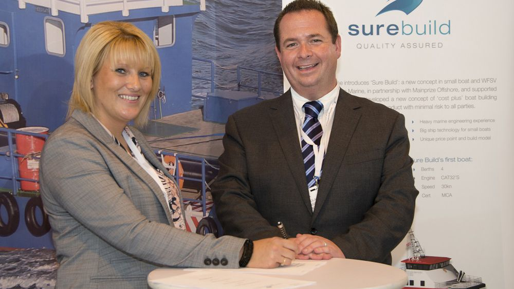 Sharon Mainprize from Mainprize Offshore and Nick Warren, managing director of Burgess Marine, sign the paperwork at Seawork 2015 for a second wind farm support vessel to be built by Burgess Marine for Mainprize. The hand over for the first completed vessel was also signed at Seawork 2015 in Southampton