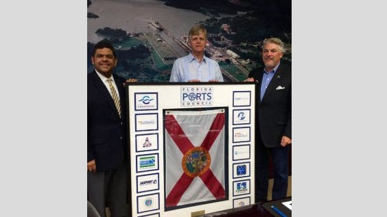 Port Everglades joins the Panama Canal Expansion Celebration in June with Chief Executive Steve Cernak (middle), joined by Port Tampa Bay CEO Paul Anderson (right), presenting a plaque on behalf of the Florida Port's Council for a presentation to Oscar E. Bazán V., Executive Vice President, Planning and Business Development, Panama Canal Authority (left).
