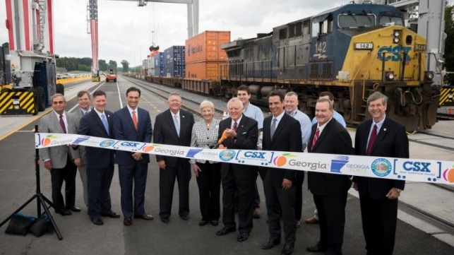 Gov. Nathan Deal, center, cuts a ribbon during the Grand Opening of the Appalachian Regional Port.