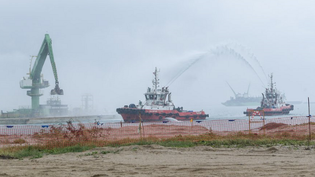 Filling of dredged materials into the final caisson to lock its position.