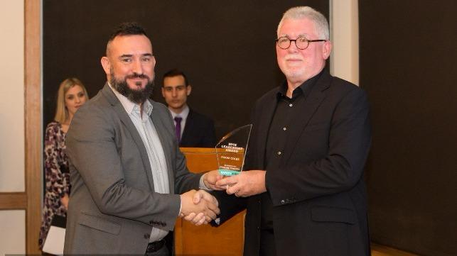 Frank Coles receives award