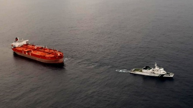 blacked out oil tanker towed by Indian Coast Guard