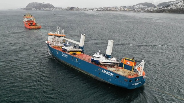 drifting heavy-lift vessel brough to port