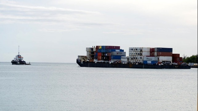 21 shipping containers fell into the ocean from a barge off Hilo Hawaii
