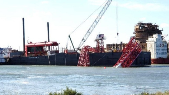 Collapsed crane boom on Atlantic Giant II. In background are TOPS DB1 and BOABARGE 29. (Photo by Coast Guard)