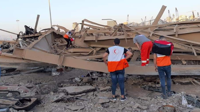 wreckage in beirut with search team